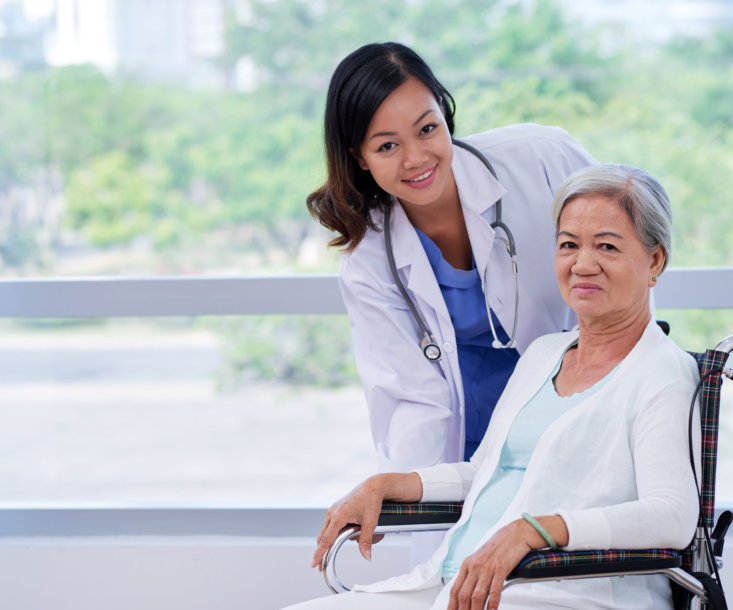 smiling female doctor and her patient