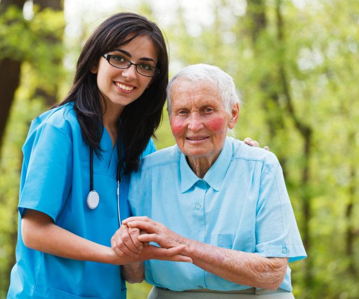 medical staff assisting an elderly woman